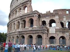 Colosseum outside; Gerald before Chianti area dinner; Ros in St Marks Square and new bridge near station